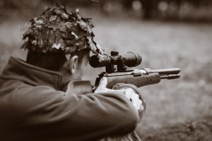 Hunter On The Prowl With A Hunting Rifle
