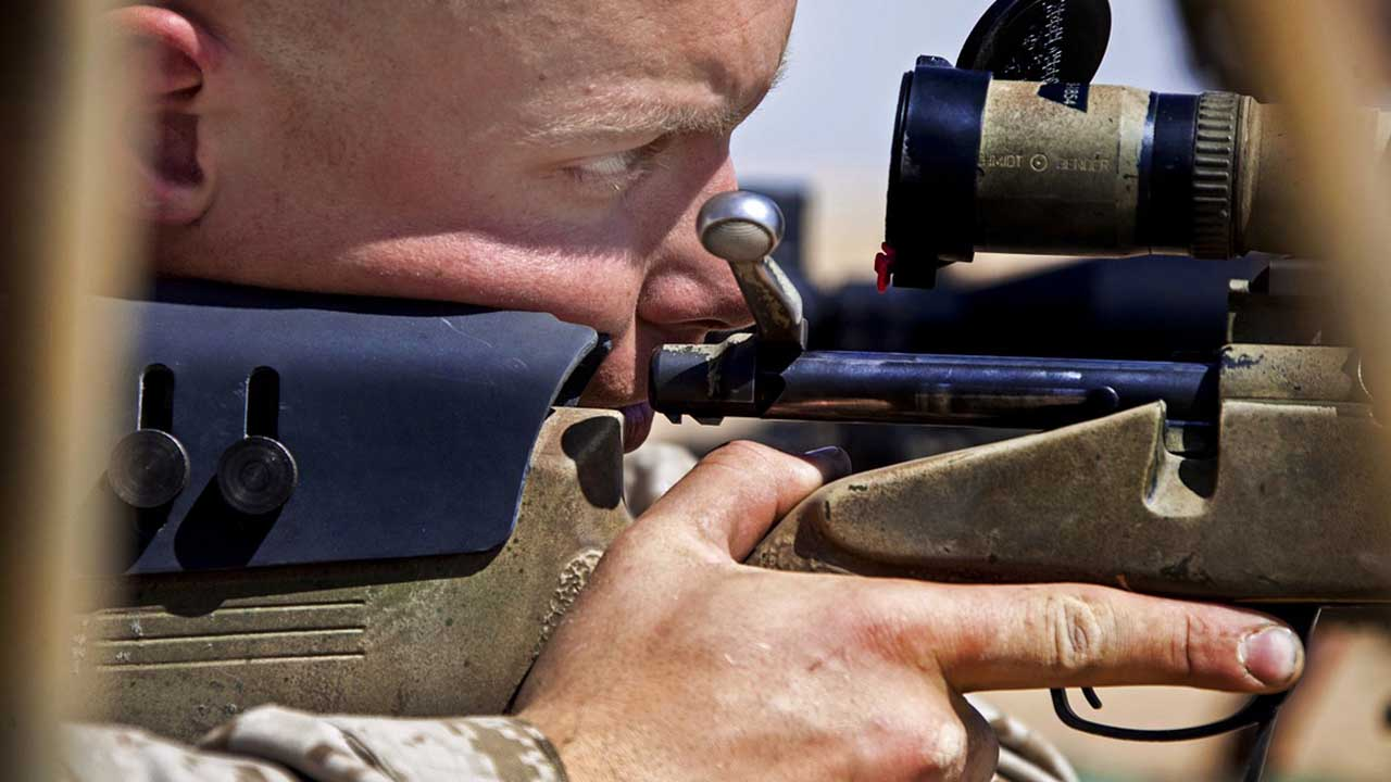 Man looking through the Rifle Scope
